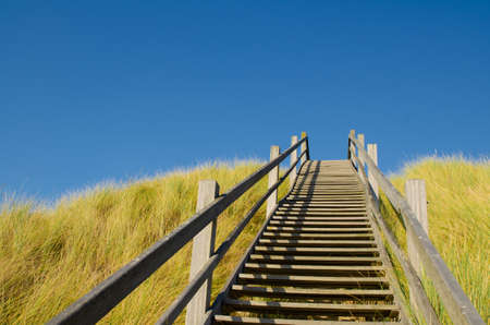 Westkapelle, The Netherlands, August 2019. The beaches in this location are wide and clean. To overcome the dunes that surround them, special wooden staircases allow easy access to the beach.