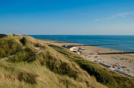 Westkapelle, The Netherlands, August 2019. The beaches of this location are wide and clean: on a beautiful sunny summer day a lot of people enjoy the sea. Redactioneel