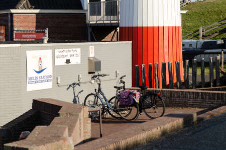 Netherlands, weastkapelle. August 2019. Near the lighthouse there is a free charging point for electric bikes. Redactioneel