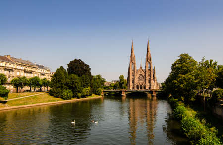 A nice view on The St. Paul's Church of Strasbourg, France. It is located on the point where the Ill and Aare rivers join. Beautiful sunny summer day.