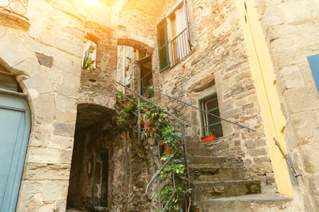 Fascinating glimpses of the alleys of Corniglia. Narrow stone streets and charming atmosphere of the Cinque Terre i Ligura, Italy. Famous travel destinations.