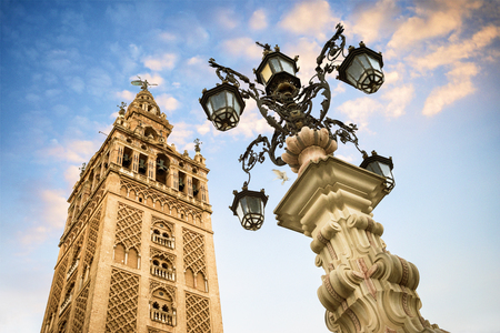 The Giralda, bell tower of the Cathedral of Seville in Seville, Andalusia, Spain Фото со стока