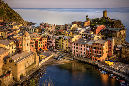 Vernazza fisherman village at sunset. Vernazza is one of five famous colorful villages of Cinque Terre in Italy, suspended between sea and land on sheer cliffs. Liguria, Italy Stock Photo
