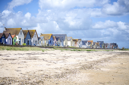 Normandy, Grand Hameau des Dunes. Row of colorful houses on the beach. Cotentin. Normandy. France.