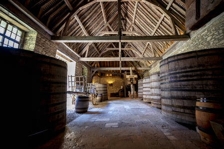 Chateau du Clos de Vougeot. Old casks of a winery in Burgundy. France. Editorial
