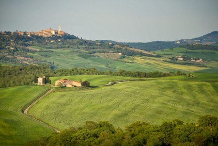 Pienza: Chapel of the Madonna of Vitaleta with the city of Pienza in the background. Siena, Tuscany, Italy.