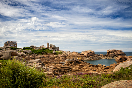 Ploumanach Mean Ruz lighthouse between rocks in pink granite coast, Perros Guirec, Brittany, France.