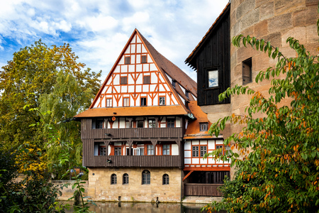Nuremberg - Half Timbering Houses, Hangmans Bridge over the Pegnitz River. Franconia, Germany