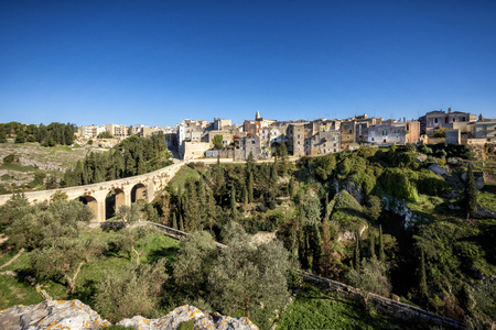 Gravina in Puglia, with the Roman two-level bridge that extends over the canyon. Apulia, Bari, Italy.
