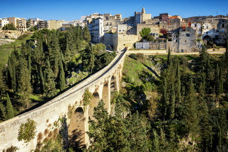 Gravina in Puglia, with the Roman two-level bridge that extends over the canyon. Apulia, Italy