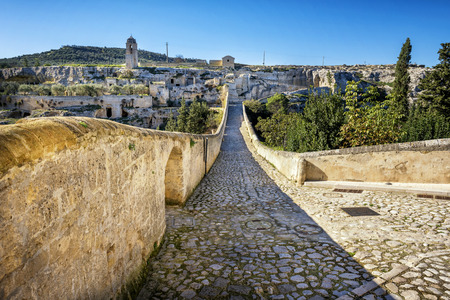 Gravina in Puglia, with the Roman two-level bridge that extends over the canyon. Apulia, Italy. Stockfoto