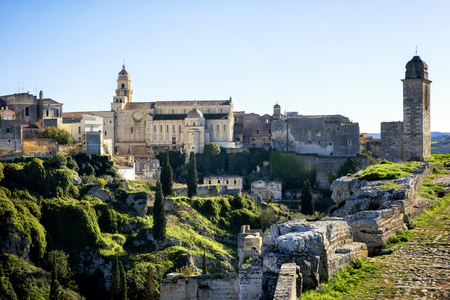 Gravina in Puglia: picturesque landscape of the the deep ravine and the old town with the ancient cathedral, Bari, Apulia, Italy