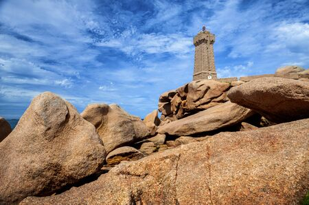 Ploumanac'h Mean Ruz lighthouse between the rocks in pink granite coast, Perros Guirec, Brittany, France.