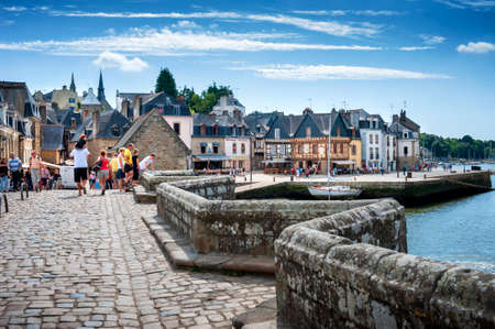 Auray - Port of Saint-Goustan. Tourists walking in the historical center. Brittany, France