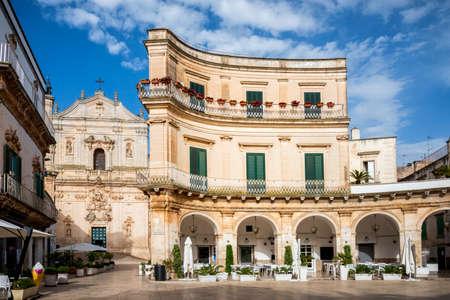 Martina Franca, Puglia. Piazza Plebiscito and Basilica di San Martino. Landmark of Apulia at sunset light, Italy.