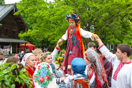 rites: Novgorod, RUSSIA - May 31, 2015, Reconstruction of the ancient Slavic pagan rites spike, walking spikelets. Trinity festivities , May 31, 2015 in Novgorod, Russia Editorial
