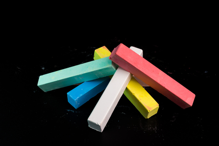 white chalks: Colored chalk on a blackboard background