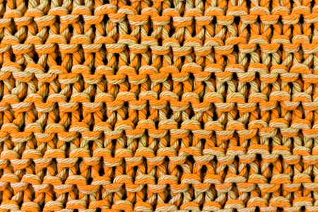 Handmade orange knitting texture background