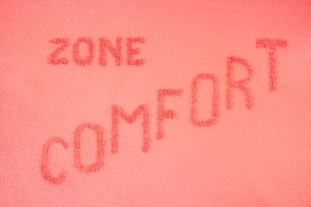Comfort zone concept. The inscription is made on a pink blanket