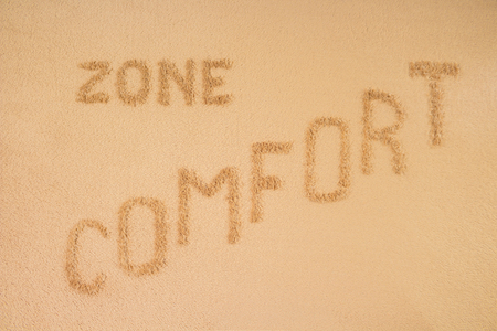 Comfort zone concept. The inscription is made on a brown blanket Фото со стока