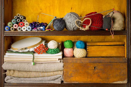 Shelves filled with materials and tools for handmade, embroidery and knitting