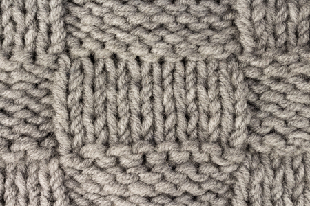 Knitting. Gray knit fabric texture background or knitted pattern background