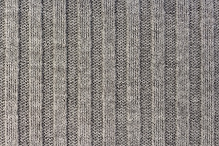 Knitting. Vertical striped gray knit fabric texture, knitted pattern background