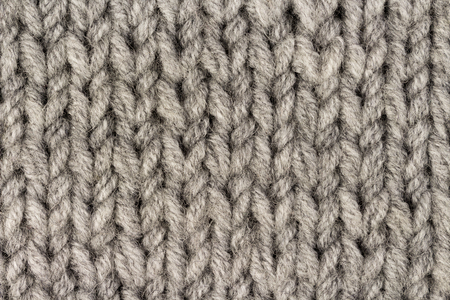 Gray knitting wool texture background. Macro