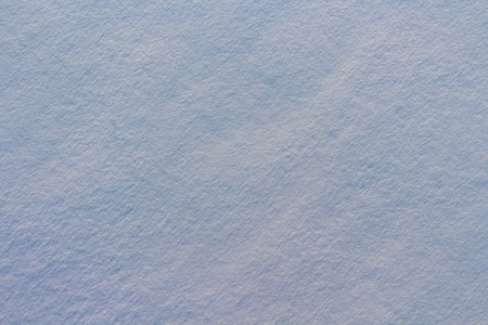 Texture of snow in blue light