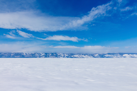 Winter landscape. Beautiful view of the snow-capped mountains in Lake Baikal