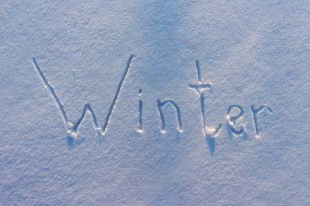 The word Winter written on snow