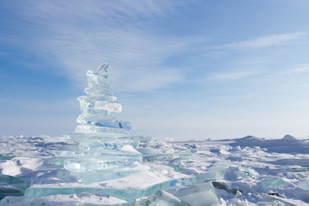 Winter Landscape. Crystal clear ice chunks. Pyramid of clear ice of Lake Baikal