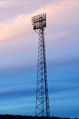 floodlights: Silouette of floodlights against colourfull clouds Stock Photo