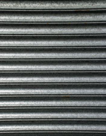close-up of al corrugated steel roller shutter photo