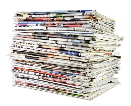 pile reuse: large stack of folded newspapers ready for recycling