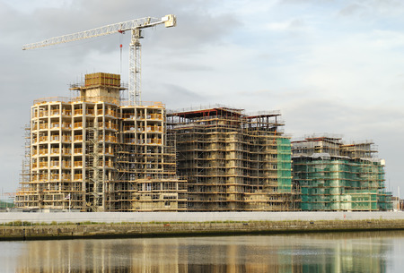 erect: construction of apartments along the side of a marina