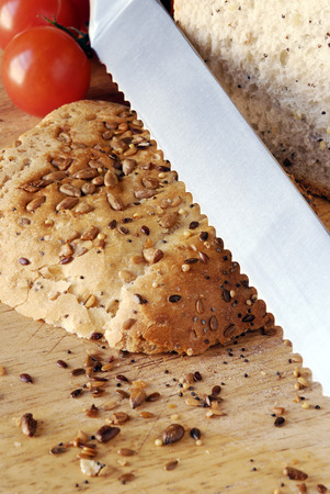 serrated: sliced seeded bread with close up of serrated bread knife Stock Photo