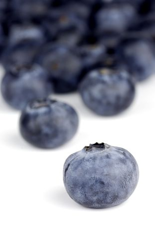 blueberries on white background with one isolated blueberry