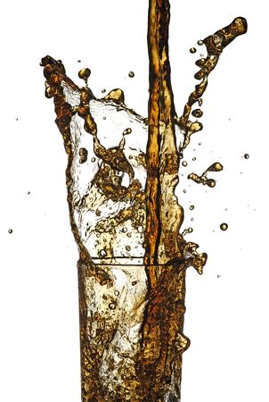 cola being poured in to a glass from a height