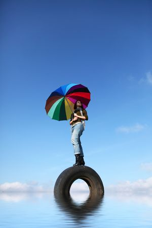 Girl staying at rall with umbrella (abstract water) Stock Photo - 5820117