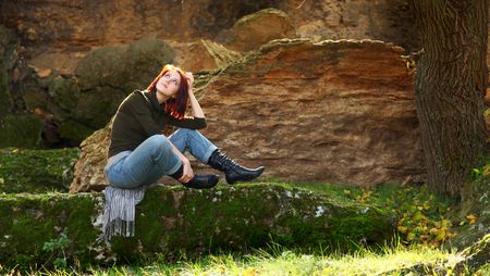 Girl sitting at stone in forst Stock Photo - 5820125