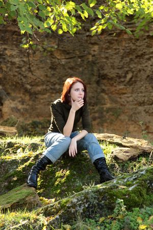 Girl sitting at stone in forst Stock Photo - 5820124