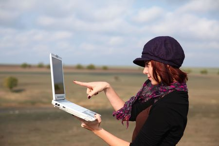 Young smiling woman holding laptop computer photo