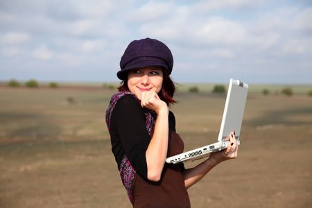 Young smiling woman holding laptop computer Stock Photo - 5820137