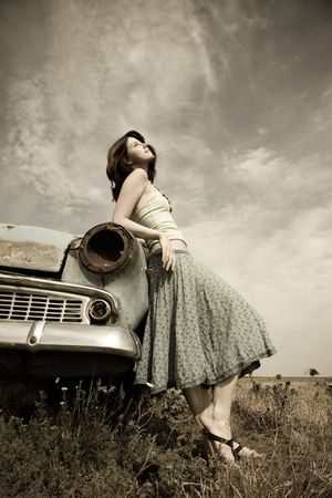 russian car: girl near old car, photo in vintage style