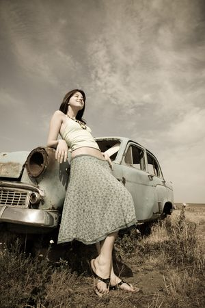 girl near old car, photo in vintage style  photo
