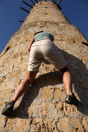 Girl climbing at tower  photo