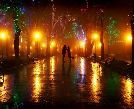 Couple walking at alley in night lights. photo
