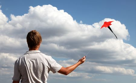 Boy play with fly kite Stock Photo - 5879026