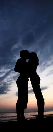 Two kissing at sunset Stock Photo - 5878974